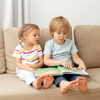 Childrens on couch reading