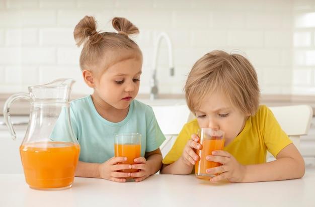 Childrens drinking juice