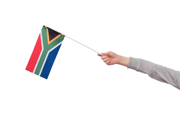 Childrens hand holds flag of south africa isolated on white background. mockup