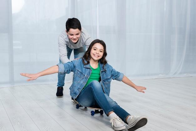 Childrens riding skateboard