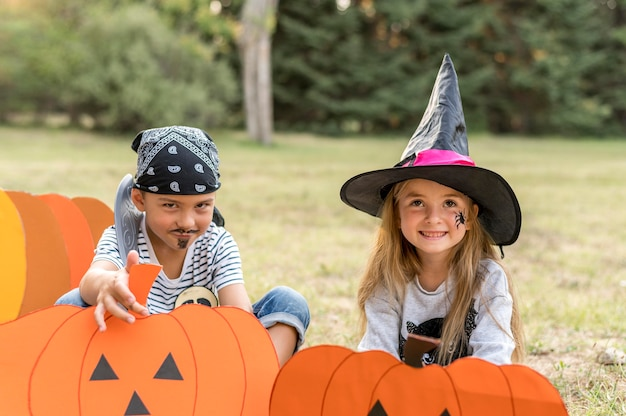 Childrens with costumes for halloween