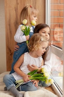 Childrens with flowers