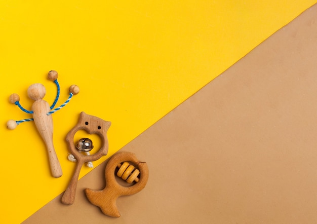 Childrens wooden toys rattles and teethers copy space