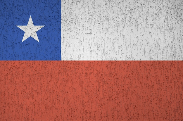 Chile flag depicted in bright paint colors on old relief plastering background