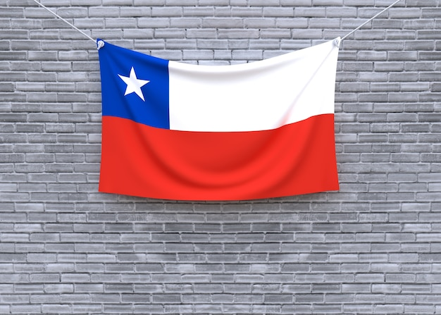 Chile flag hanging on brick wall
