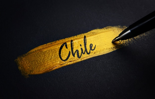 Chile handwriting text on golden paint brush stroke