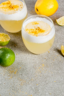 Chilean traditional drink pisco sour liqueur with fresh lime