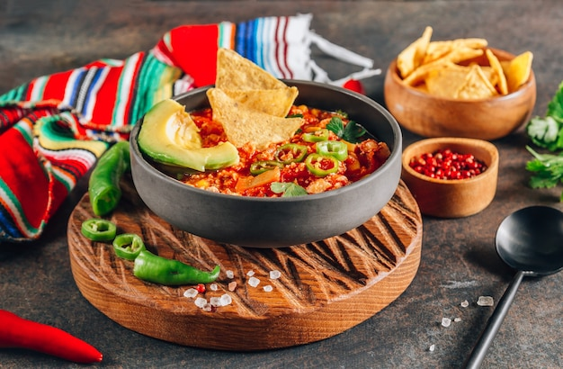 Chili con carne in bowl with tortilla chips