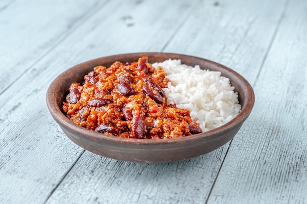 Chili con carne served with white long-grain rice