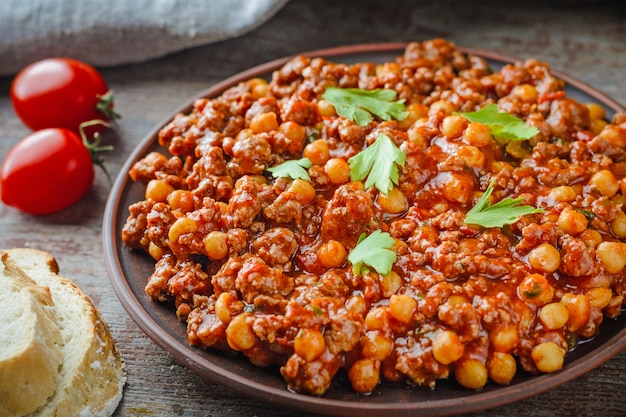 Chili con carne with pork and chickpeas. mexican or texas traditional food