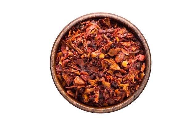 分離された木製のボウルに唐辛子フレークスパイス。調味料上面図