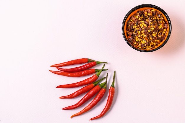 Chili pepper spices and fresh red chilli peppers.