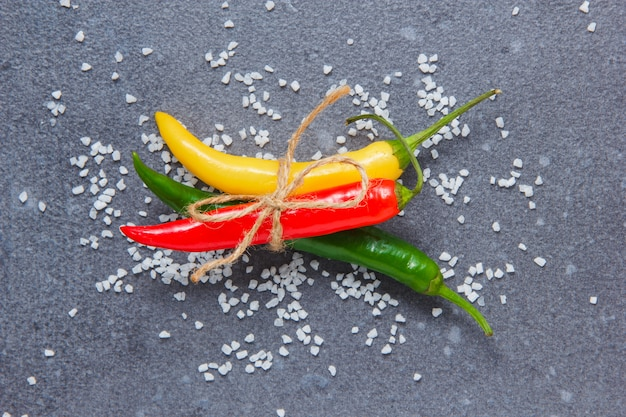 Chili peppers on a gray surface. top view.