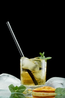 Chilled alcoholic cocktail with ice and boiler tube