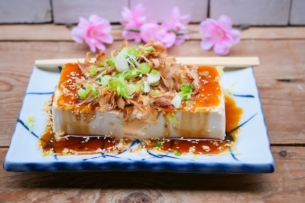 Chilled tofu topped with grated ginger, sliced japanese ginger, green onion,
