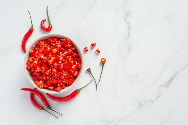 Chilli pepper on white surface