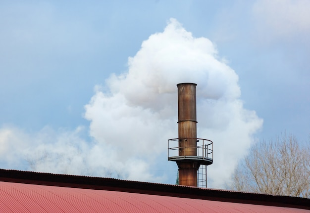 Chimney of a factory, industrial process that produces white smoke.