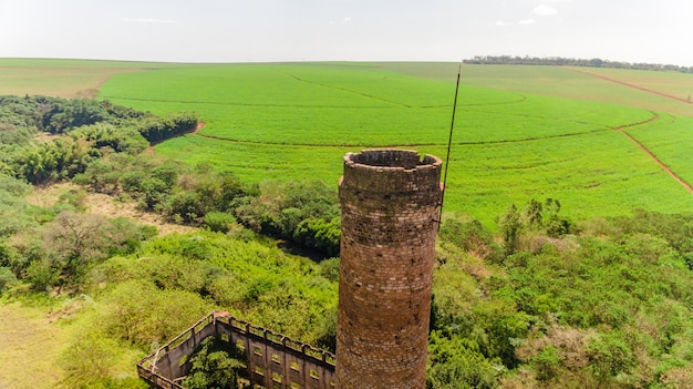 Chimney of the old alcohol plant. sugar cane plantations. aerial image