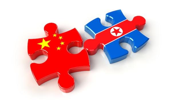 퍼즐 조각에 중국과 북한 국기. 정치적인 관계 개념입니다. 3d 렌더링