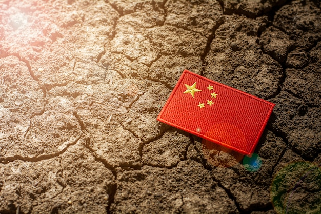 China flag on abandoned cracked ground.