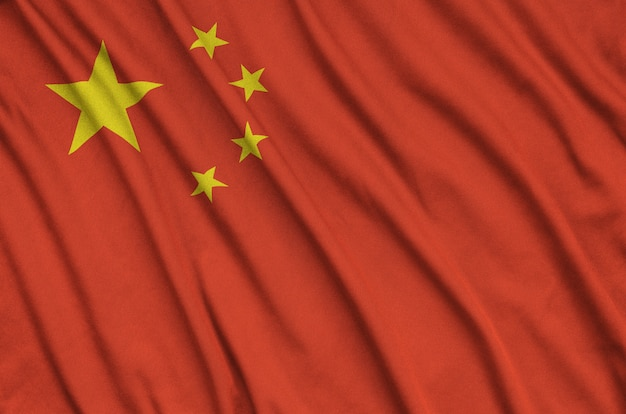 China flag is depicted on a sports cloth fabric with many folds.