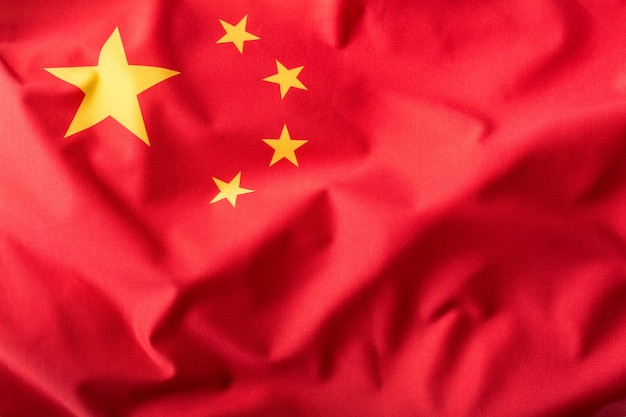 China flag. peoples republic of china flag blowing in the wind.