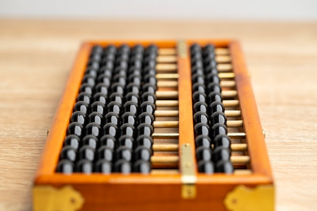 Chinese abacus vintage on the brown wood table front view and copy space