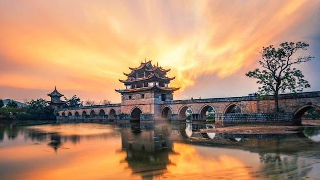 Chinese ancient bridge sunset