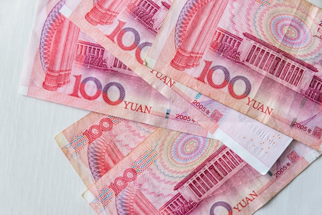 Chinese banknotes yuan renminbi on wooden background