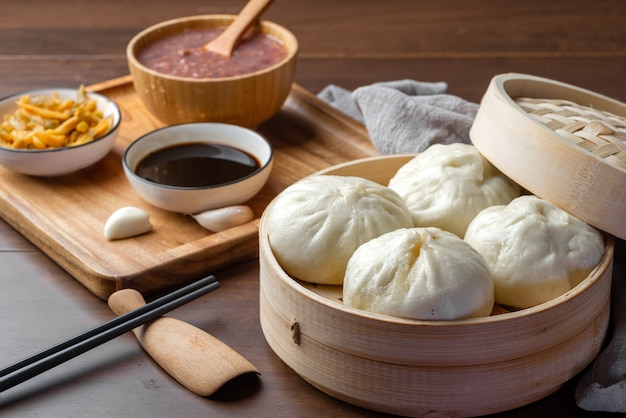 Chinese breakfast. steamed buns and porridge are on the table