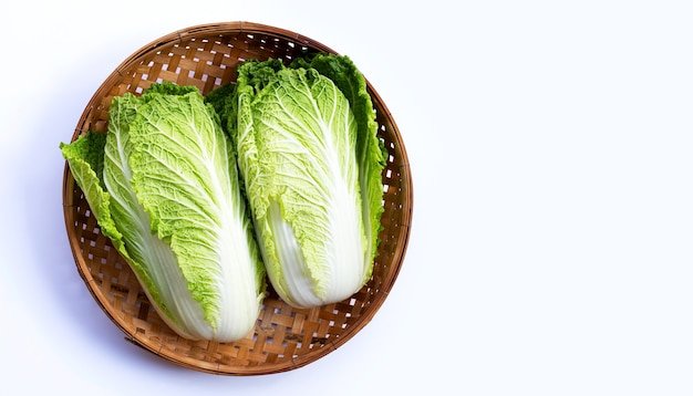 Chinese cabbage in bamboo basket on white surface