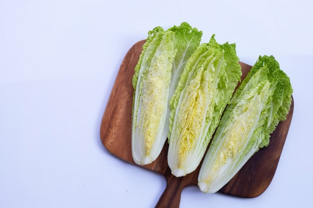 Chinese cabbage on cutting board on white background. copy space