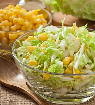 Chinese cabbage salad with sweet corn in a glass bowl