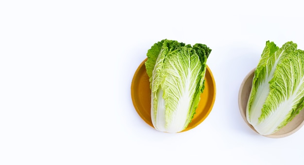 Chinese cabbage on white surface
