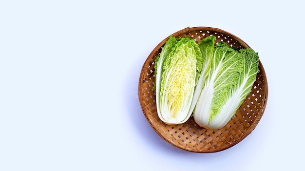 Chinese cabbage on white wall. copy space