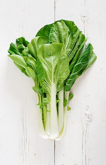 Chinese cabbage on white wooden table.