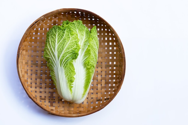 Chinese cabbage in wooden bamboo threshing basket on white