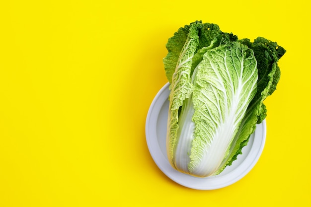 Chinese cabbage on yellow table.