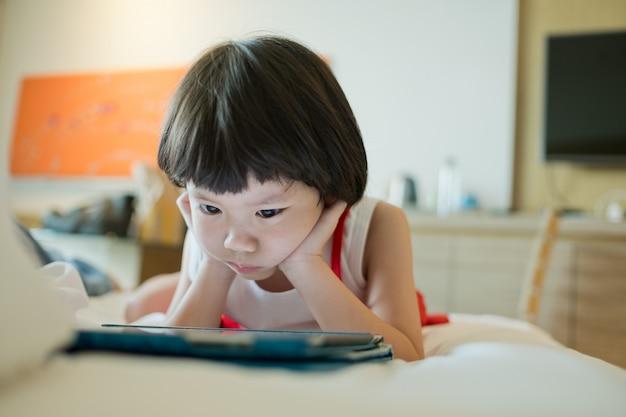 Chinese child addicted phone, asian girl playing smartphone, kid use telephone, watching cartoon
