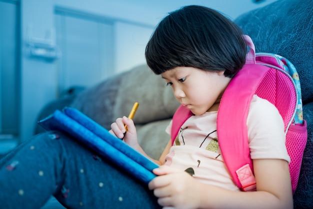 Chinese child addicted phone asian girl playing smartphone kid watching cartoon