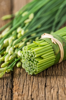 Chinese chives on wood