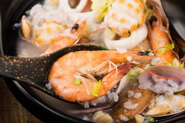 Chinese cuisine. a casserole chaoshan seafood porridge. seafood porridge