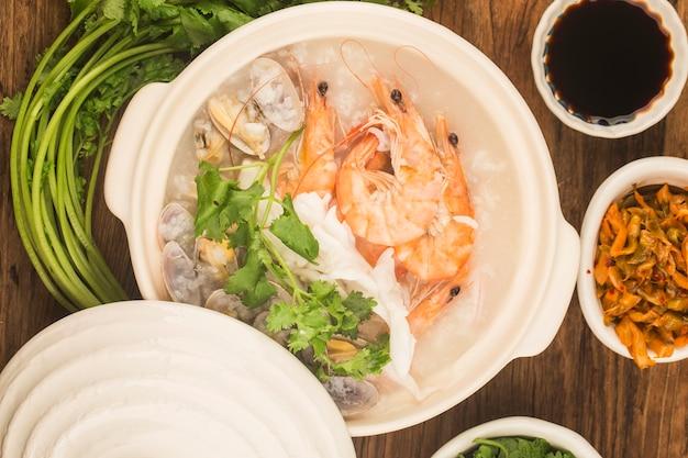 Chinese cuisine:a casserole chaoshan seafood porridge.seafood porridge