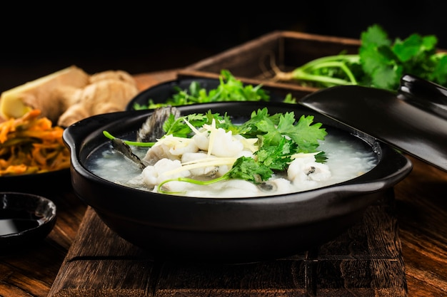 Chinese cuisine congee with fish slices in casserole