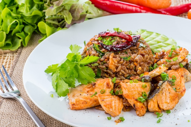 Chinese cuisine, salt salmon fish and egg fried rice and vegetables with ingredients