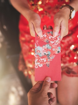 Chinese culture in chinese new year, people will giving red envelope.