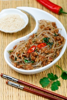 Chinese dish of starch glass noodles (rice, potatoes, beans) with meat