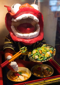 Chinese dragon character presenting traditional food