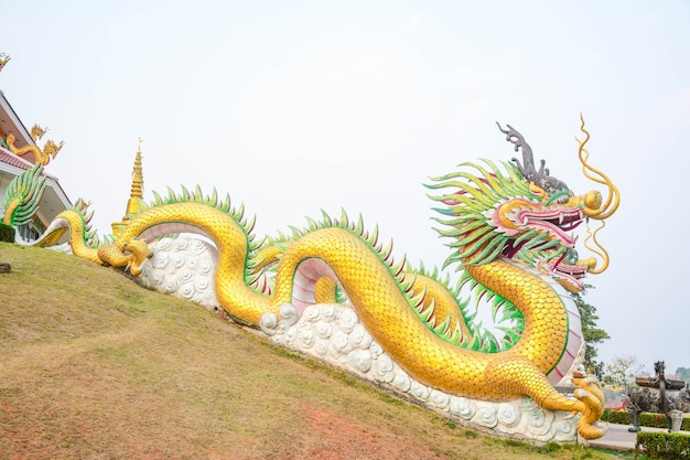 Chinese dragon in the sky and incense holder - thai temple