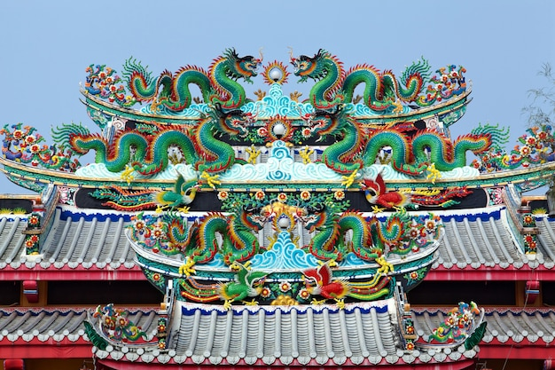 Chinese dragon statue on the roof of the chinese temple in thailand